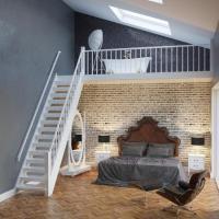 Exklusive Vintage Stil Möbel in einer Hotelloft - Fußboden und Wandgestaltung hier allerdings in einer schlechten Zusammenstellung