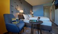 Frische Farben und lässiger Stil: Die Zimmer im 4Rest Hotel Hall / Bildquelle: IBB Hotel Collection