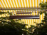 Schon unmittelbar nach dem Einschalten können sich die Gäste an der wohligen Wärme erfreuen, die die formschönen Infrarot-Heizstrahler von AEG abgeben / Bildquelle: AEG Haustechnik - Stadler