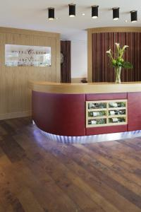 Kunststoff-Designbodenbeläge im Scandotel Castor Berlin, hier die Hotelrezeption, Bilderquellen alle Bilder PROJECT FLOORS GmbH