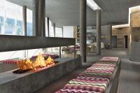 Die Lobby mit Kamin / © Lorenzo Bellini Associates, Rom