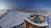 Winterpanorama mit alpina und Sicht auf Skypool / Quelle: alpina zillertal
