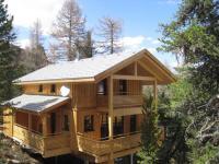 Chalet-Aussenansicht Alpenpark Turracher Höhe / Quelle: Alps Residence
