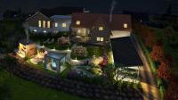 Außenansicht Golden Hill Landhaus Steinfuchs bei Nacht - gezoomt / Bildquelle: Golden Hill Country Chalets & Suites