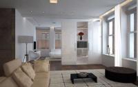 Schrank als Raumteiler zwischen Wohn- und Schlafbereich im Hotelzimmer im weißen Hochglanz