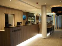 Die Rezeption im relexa Hotel München, gleichzeitig Bildquelle