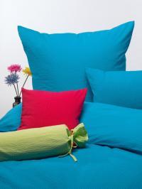 Foto B: Bettwäsche aus Soft-Seersucker in den Farben Lemon, Türkis und Rot; Foto: Wäschekrone