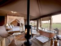 Höchster Luxus inmitten der Savanne im Safari-Camp One Nature Nyaruswiga. / Bildquelle: One Nature Hotels & Resorts