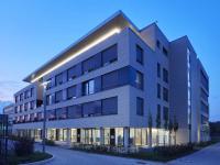 Außenansicht des Connext-Campus mit Büros, Kita, Hotel und Spabereich. / Bildquelle: Beide Bilder SALTO Systems
