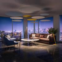 Zusatzgeschäft für den Innenausbauer mit Rosso-Akustik. Im Bild ein modernes Apartement mit dem Nimbus Lighting Pad, einer neuen Möglichkeit zur Integration von Schalldämmung und LED-Licht in einem Produkt